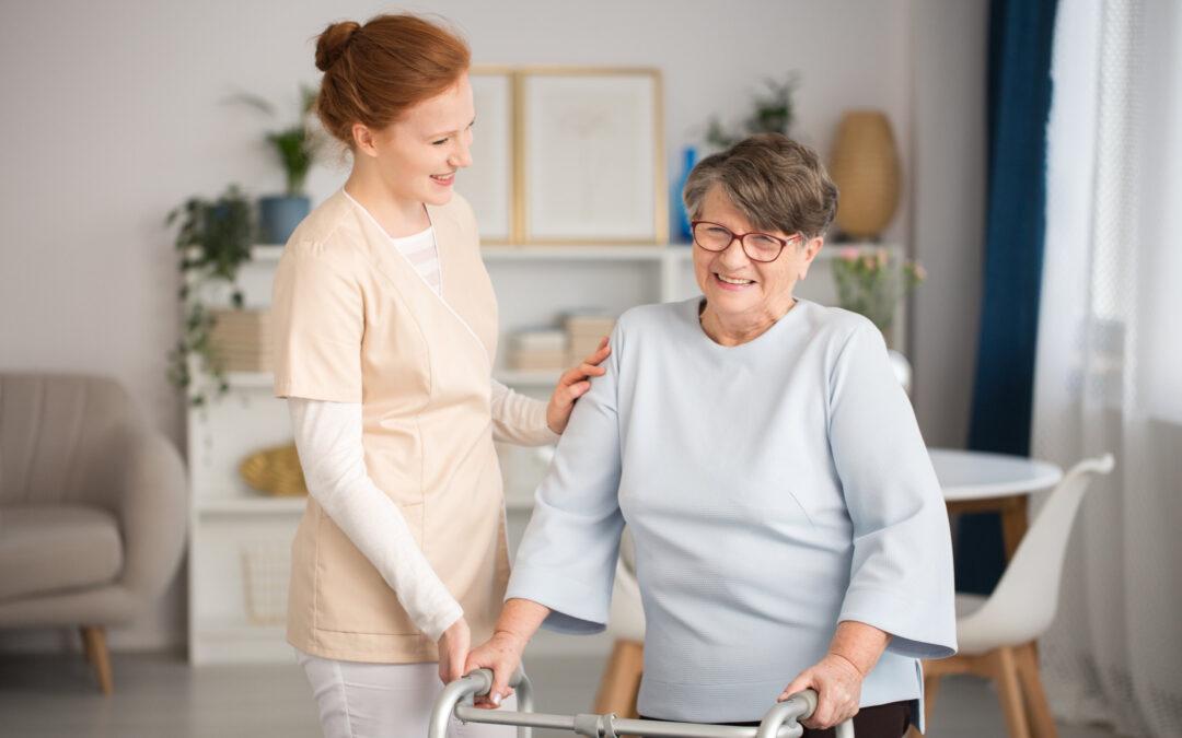 senior walking with nurse